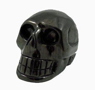 Hand Carved Skull Sculpture Made Out of Jet, a Natural Organic Fossilized Matter. Like a Crystal Stone Rock Carving, Jet has New Age Metaphysical Healing Properties. This Artistic Lapidary Piece is also Jet Black in Color and Highly Polished. It Measures A