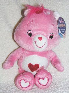 "2007 The New Care Bears   Special Edition 10"" Plush Lil' Glows Love A Lot Bear   Glow in the Dark Bear Toys & Games"